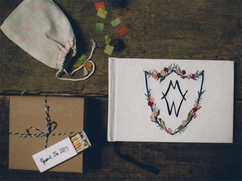 Above: more wedding details incorporating my illustrations- on the left, matchbooks printed with the hand-lettered wedding date, and on the right a beautiful guest book hand-embroidered with the crest I illustrated for Danielle and Brad. Image by  Lelia Scarfiotti.