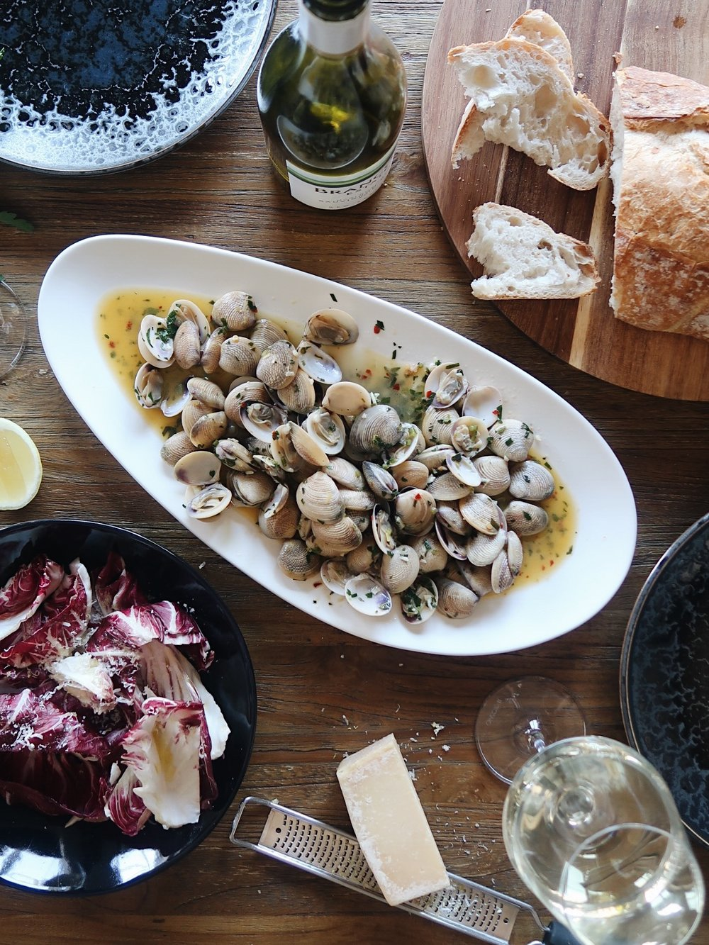 VONGOLE WITH HERBS AND WHITE WINE. - Everyone has a dish that transports them to their happy place – this is mine. You'll be forgiven if my Vongole renders you silent and the only noises you make is the slurping of pippie shells and the sipping of Brancott Estate Sauvignon Blanc.