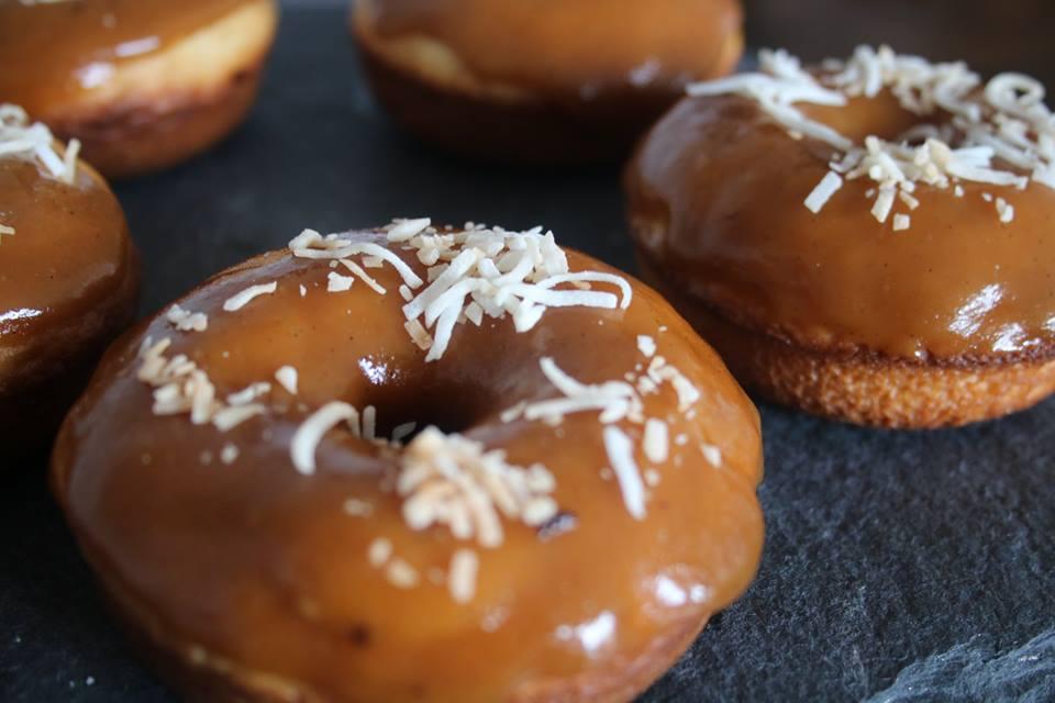 Caramel Glazed Vanilla Cake Doughnut topped with toasted coconut.jpg