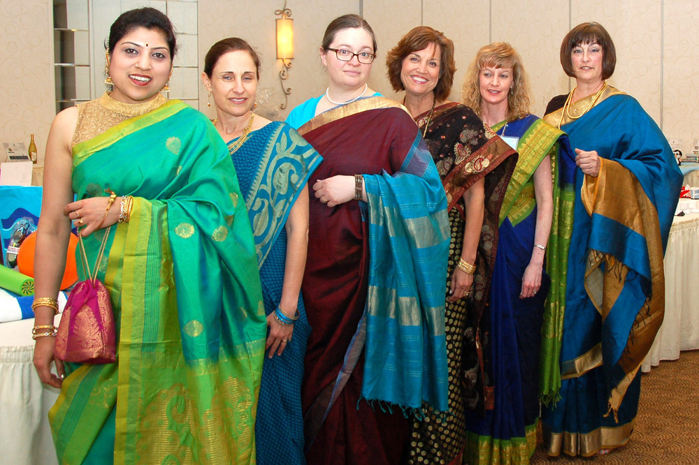 Trinity Free Clinic staff in the beautiful saris shared with us with Bhagya Lakshmi from her personal collection.  Pictured left to right:  Bhagya Lakshmi, Dina Ferchmin, Autumn Zawadzki, Cindy Love, Lisa Curry, and Amy Kazmier.