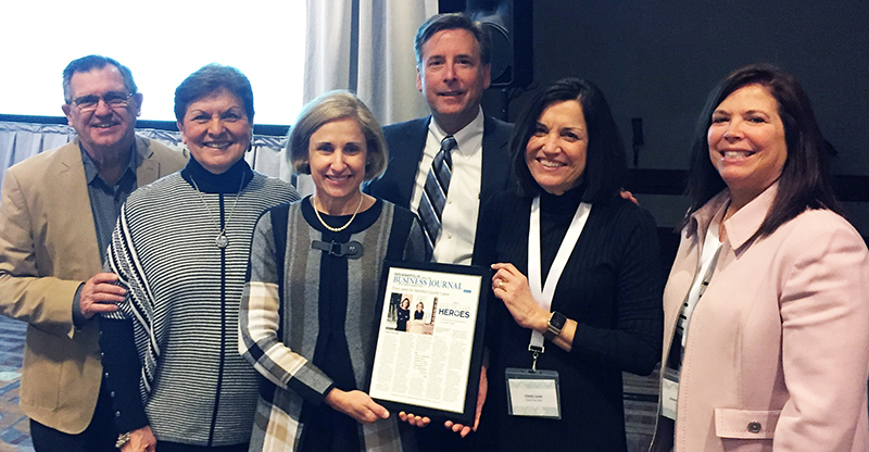 Pictured above: Long-time volunteers Tom Kueper & Ruth Kueper, R.N., Executive Director Dina Ferchmin, Board Member Larry Counen, & clinic founders Cindy Love & Joannie Kinnaman