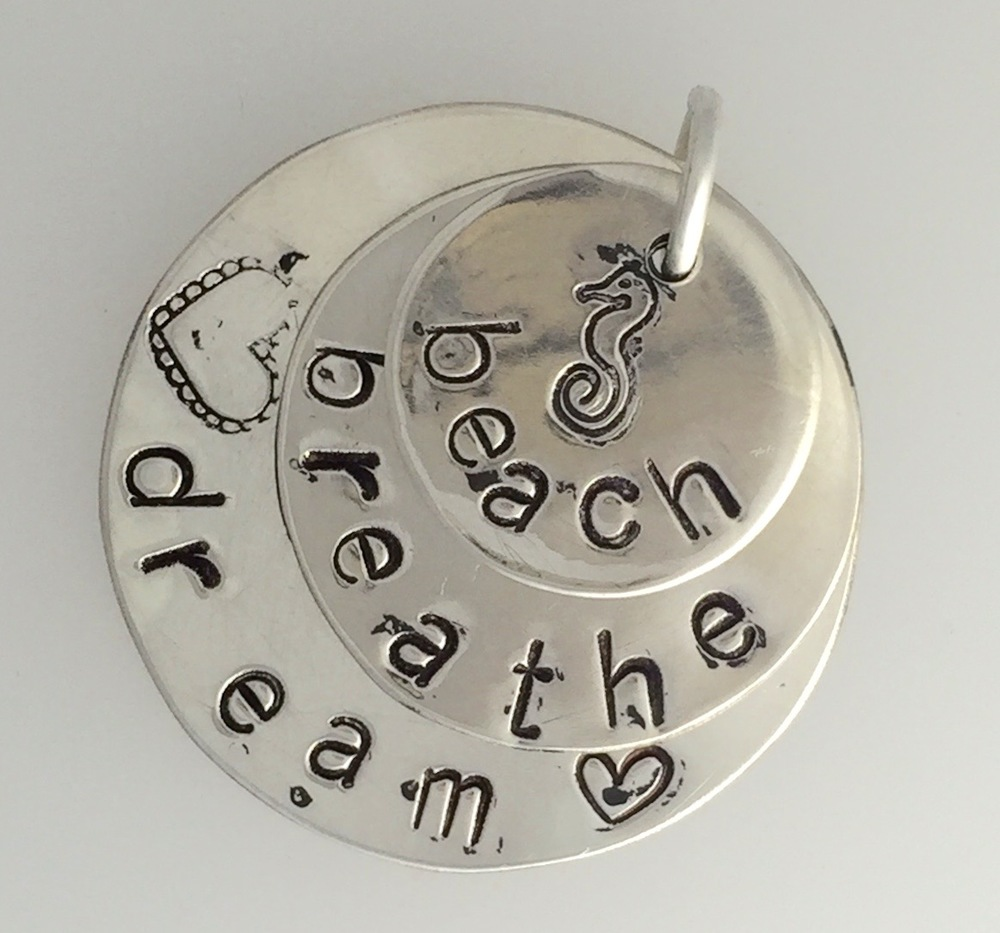 Hand stamped personalised silver pendant