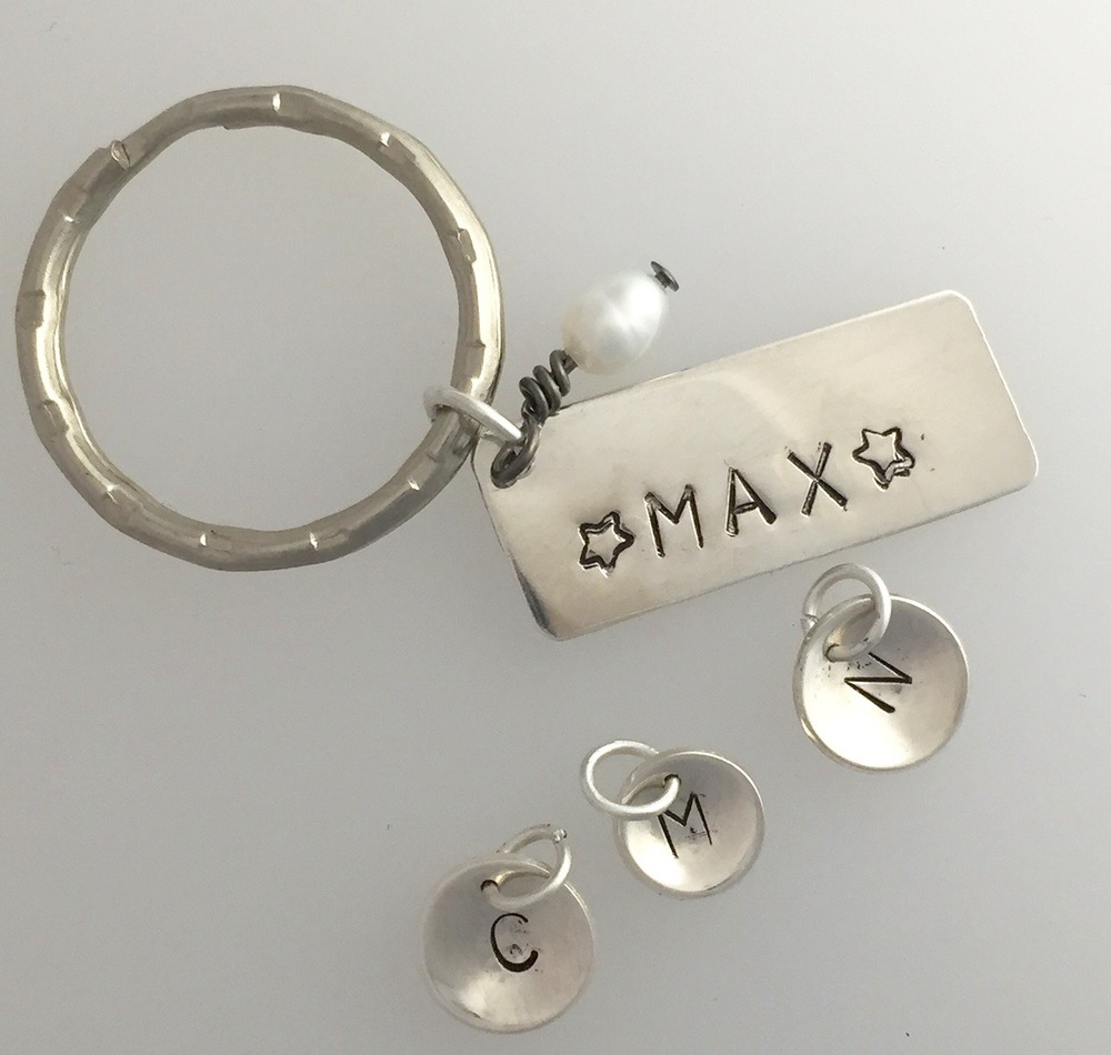 Hand stamped personalised silver charms and keyring