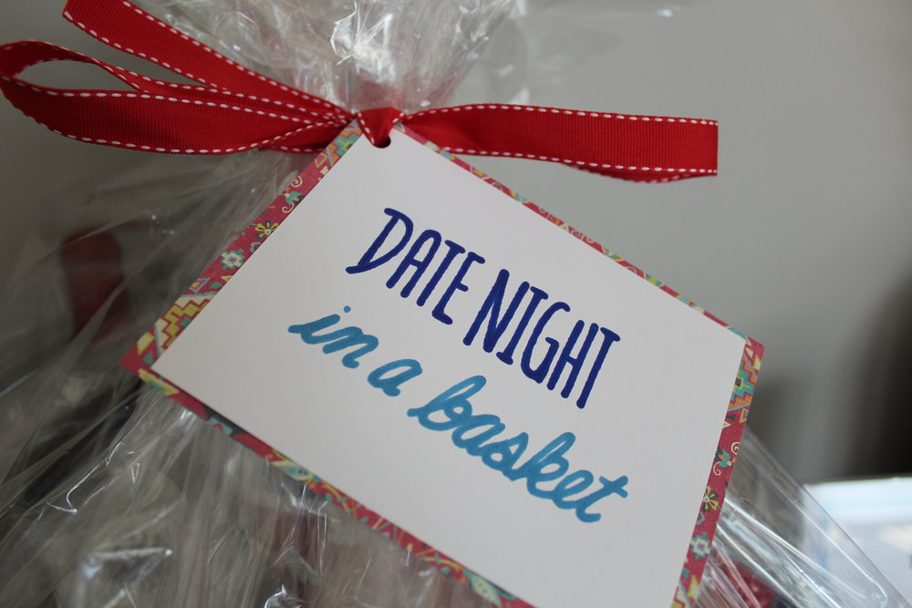 Date Night silent auction basket included 4 movie tickets & snacks, and a gift card to the Royal Oak Brewery, and more.