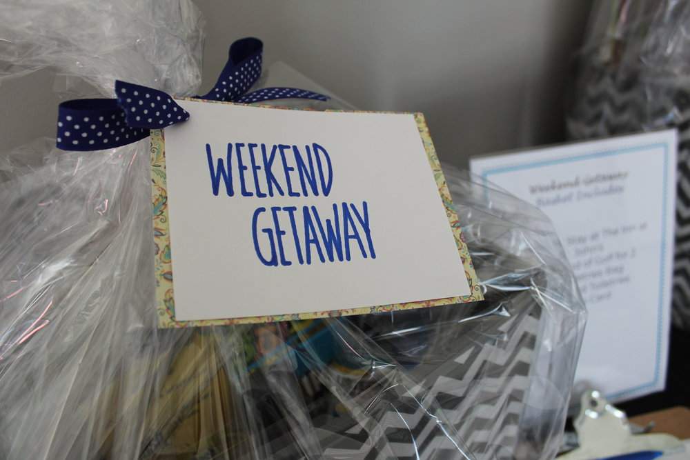 The Weekend Getaway silent auction basket included a 1 night stay and round of golf for 2 at The Inn at St. John's, and more.
