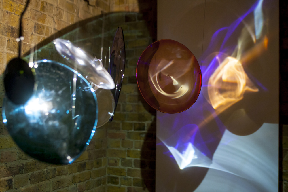 Light Paintings. Suspended hand blown glass lenses, steel, monofilament, halogen lights. 2015.