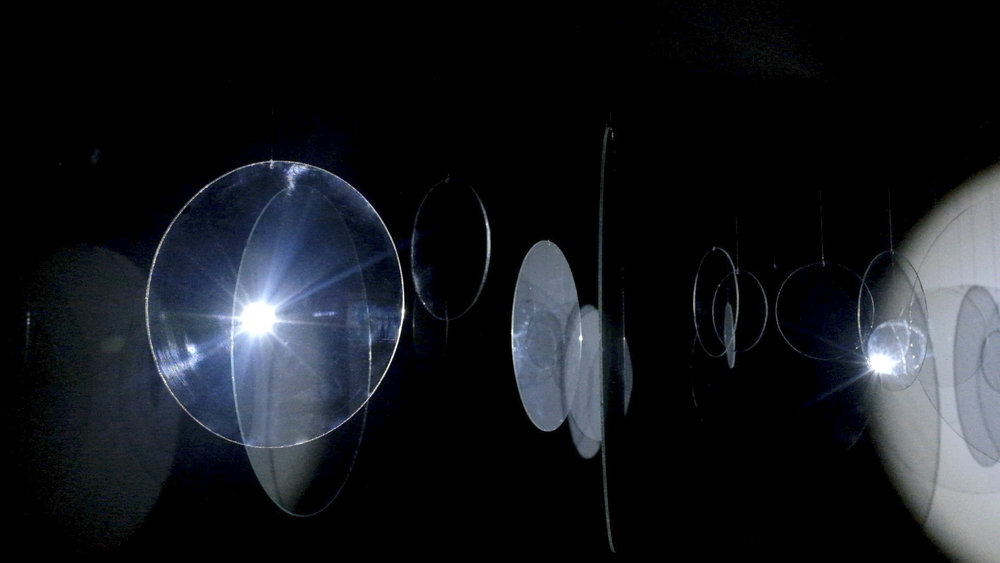 Quietude. Hand cut glass circles and LED. 2015