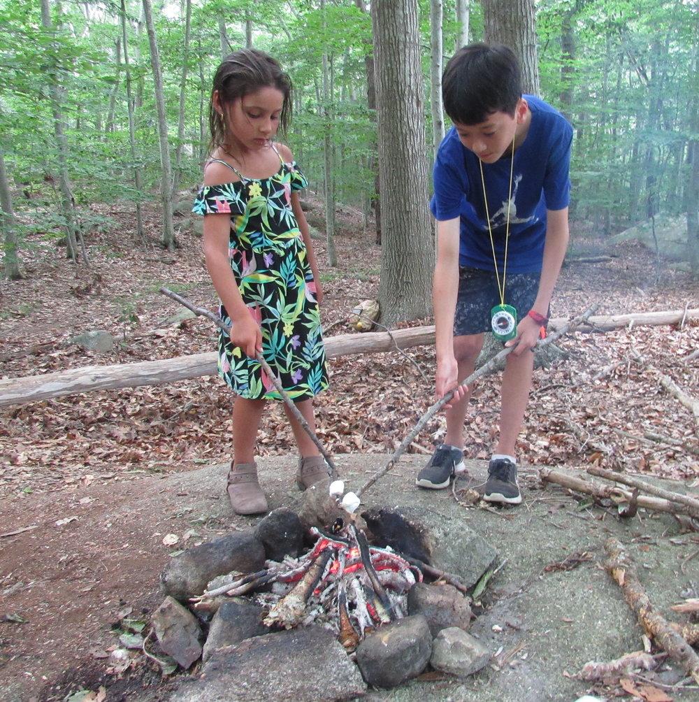 two kids toasting marshmallows.JPG