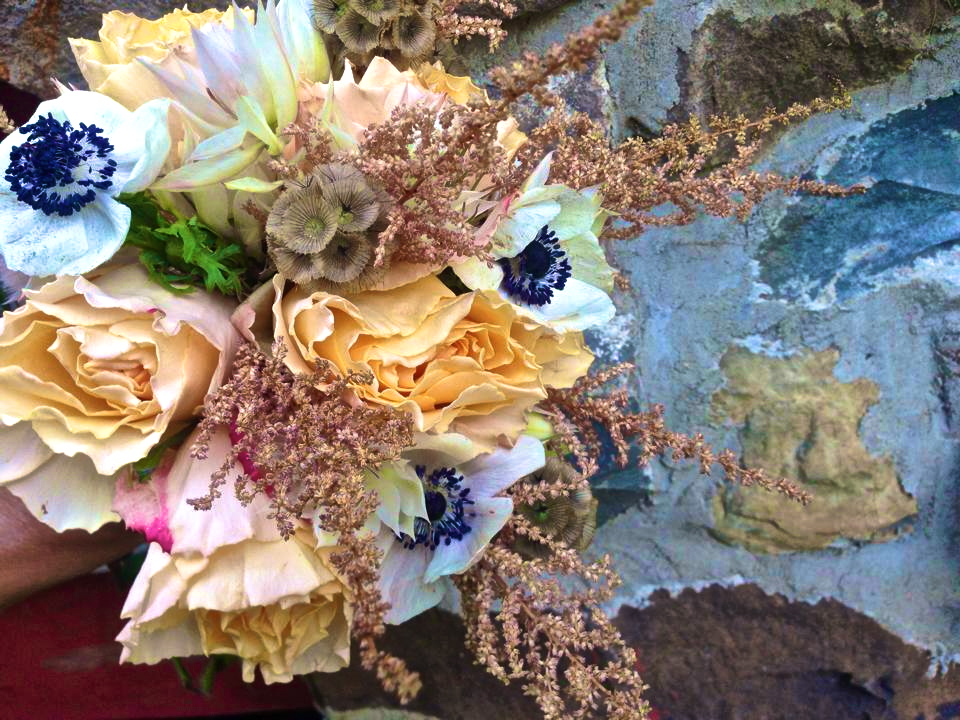 Elegant wedding bouquet focusing on small hills of texture. What's the number one flower in this arrangement? We LOVE anemones! Being a New York City florist, we love throwing in aspects that look very nature-esqu. This reminds us that there is life outside of NYC!
