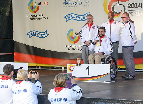 Matt Skelhon celebrates his Gold medal with Robin Taylor, Pasan Kularatne and Mike Babb