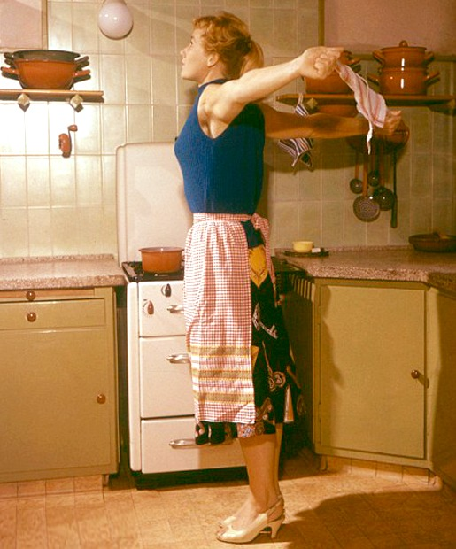 This photo is from the Stepford Wives Workout which very well may be sexist. So… gross on that. But just looking at this makes me feel better. She is opening the chest, shoulders, and collar bones without dumping in the low back and sticking ribs and belly out. Front ribs are incorporated into the body and her abdominals are gently engaged and tailbone reaches toward her heels to help lift up and out of the low back.  I like the idea that ALL humans - not just house wives - should move in heathy ways throughout the day. When I sit at the computer all day I feel my body slowly hemorrhaging into a lethargic state.  When I get up every once in a while and do a little dance or stretch I feel awake and just plain better. So, if we are to learn anything from a sexist workout, it's that whatever you're doing during your day, incorporate some stretching and strengthening throughout and you'll feel better.