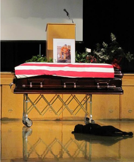 npr: The dog of slain Marine Jon Tumilson refused to leave his side during the Navy SEAL's funeral earlier this week in Rockford, Iowa. The heartbreaking photo taken by his cousin, Lisa Pembleton, shows Tumilson's dog Hawkeye lying by the casket. (via The Daily Treat: Animal Planet)