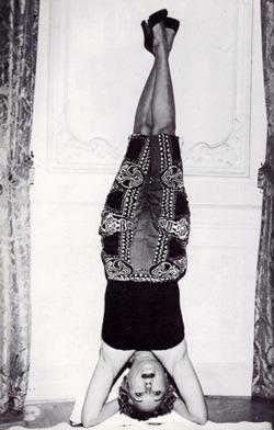 theloudestvoice :     Gloria Swanson   (image via  Need This Book )     Stylin' headstand, Gloria Swanson!