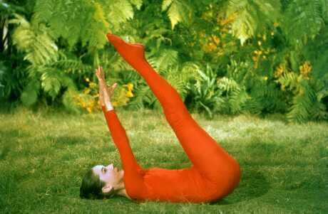 Audrey Hepburn casually yoga-ing in a red (footed!) unitard. Perhaps making her way into plough pose?  Amen. #beautifulcolors
