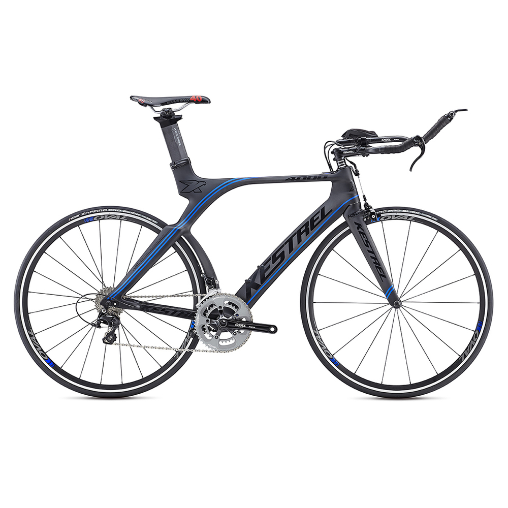4000 Shimano 105 MSRP: $2849 All models are constructed of 800K high-modulus carbon fiber: Kestrel's lightest carbon construction used only on SL (Super Light) models. Kestrel's 800K carbon uses inner polyurethane molds in high-stress areas such as the BB shell and head tube to minimize wrinkles in the carbon layers for greater compaction and stiffness to ensure the lightest and strongest frame possible. Geometry is ideal for the demands of long-distance triathlons; a slightly taller head tube allows for a more upright position to keep the legs fresh and strong for the run. Oval Concepts handlebar and stem use a traditional interface that doesn't require any special proprietary tools, allowing for easy adjustment and customization. Designed in the A2 Wind Tunnel, the stays, seat post, and seat tube are aerodynamically contoured; plus, fully internal cable routing ensures clean airflow over the entire bike,New rear stays are shaped to fit all the commonly available deep-dish and disc wheels, while preserving aerodynamics. New vertical dropouts allow for easy wheel changes and combine a secure hold with 8mm of fore-aft aerodynamic adjustability. TRP 920 Forged Aero Center Pull braking system offers reliable stopping power and excellent aerodynamics,Kestrel EMS Pro Aero Seatpost allows for the saddle to be mounted in a wide range of positions.Each of the six sizes has unique tube lengths, diameters, shapes, and carbon layups to produce the best possible ride quality for every size rider. The Shimano Ultegra model's 47cm uses 650C wheels to avoid toe overlap.