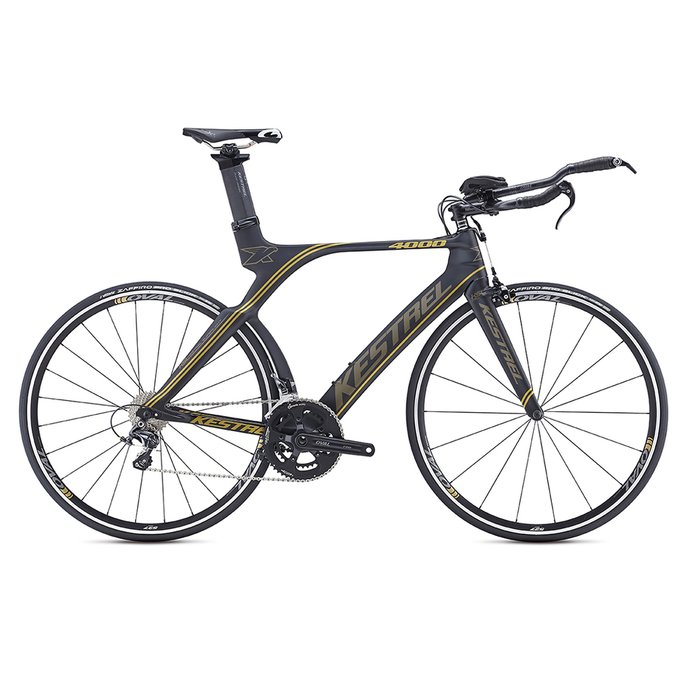 4000 Shimano Ultegra 650 MSRP: $3149 All models are constructed of 800K high-modulus carbon fiber: Kestrel's lightest carbon construction used only on SL (Super Light) models. Kestrel's 800K carbon uses inner polyurethane molds in high-stress areas such as the BB shell and head tube to minimize wrinkles in the carbon layers for greater compaction and stiffness to ensure the lightest and strongest frame possible. Geometry is ideal for the demands of long-distance triathlons; a slightly taller head tube allows for a more upright position to keep the legs fresh and strong for the run. Oval Concepts handlebar and stem use a traditional interface that doesn't require any special proprietary tools, allowing for easy adjustment and customization. Designed in the A2 Wind Tunnel, the stays, seat post, and seat tube are aerodynamically contoured; plus, fully internal cable routing ensures clean airflow over the entire bike, New rear stays are shaped to fit all the commonly available deep-dish and disc wheels, while preserving aerodynamics. New vertical dropouts allow for easy wheel changes and combine a secure hold with 8mm of fore-aft aerodynamic adjustability. TRP 920 Forged Aero Center Pull braking system offers reliable stopping power and excellent aerodynamics, Kestrel EMS Pro Aero Seatpost allows for the saddle to be mounted in a wide range of positions. Each of the six sizes has unique tube lengths, diameters, shapes, and carbon layups to produce the best possible ride quality for every size rider. The Shimano Ultegra model's 47cm uses 650C wheels to avoid toe overlap.