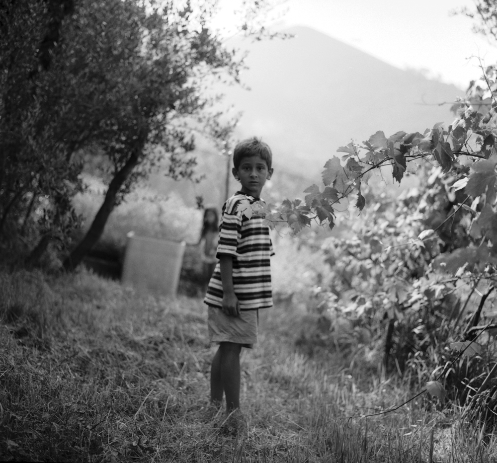 0006_italian series_lukas in the grape arbor.jpg