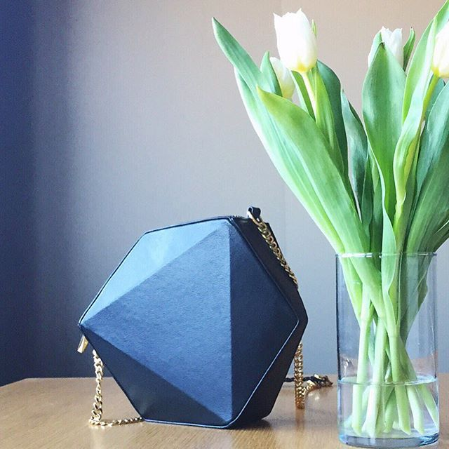 Minimalist feels this morning with white tulips and the Tri Cross body in black leather.  #minimal #minimalmood #shape #form #design #geometric #architecture #chicagodesign #chicagofashion #instastyle #instafashion #purseblog #purseforum #fashion #style