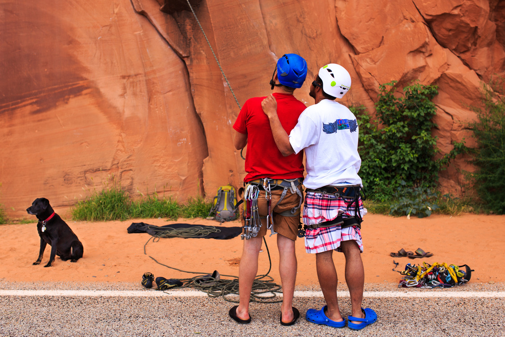 Jesse Spiegel belays a rock climber with Anthony DeJesus and Gordo, the dog, near Moab, Utah during the adventure road trip documented in the the film Rewilding.  Download a High Resolution JPEG Image (6.41 MB)