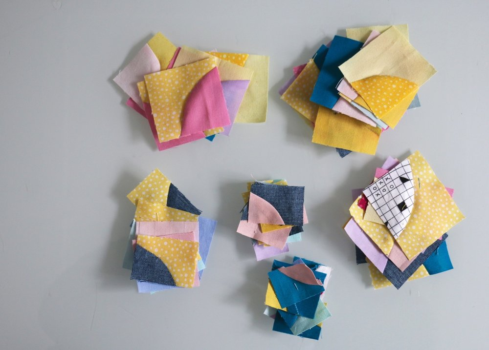 Tiny improv Drunkards Path quilt blocks