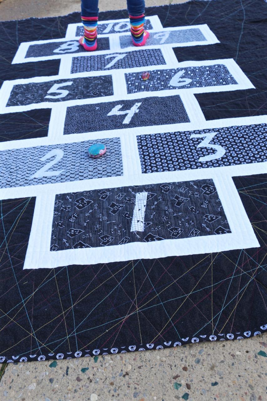 Hopscotch quilt Tag Fabrics