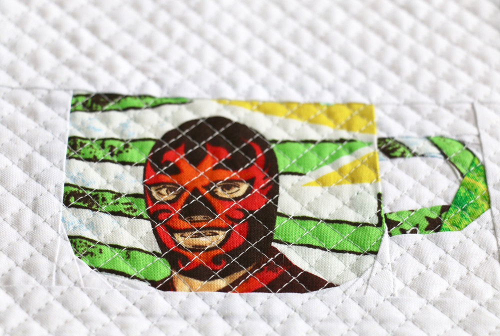 The Mug Club Luchadores on a quilt
