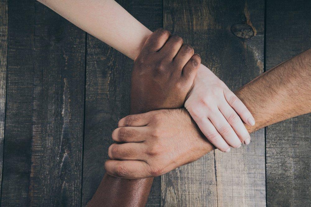 team-hands-linked-together_4460x4460.jpg