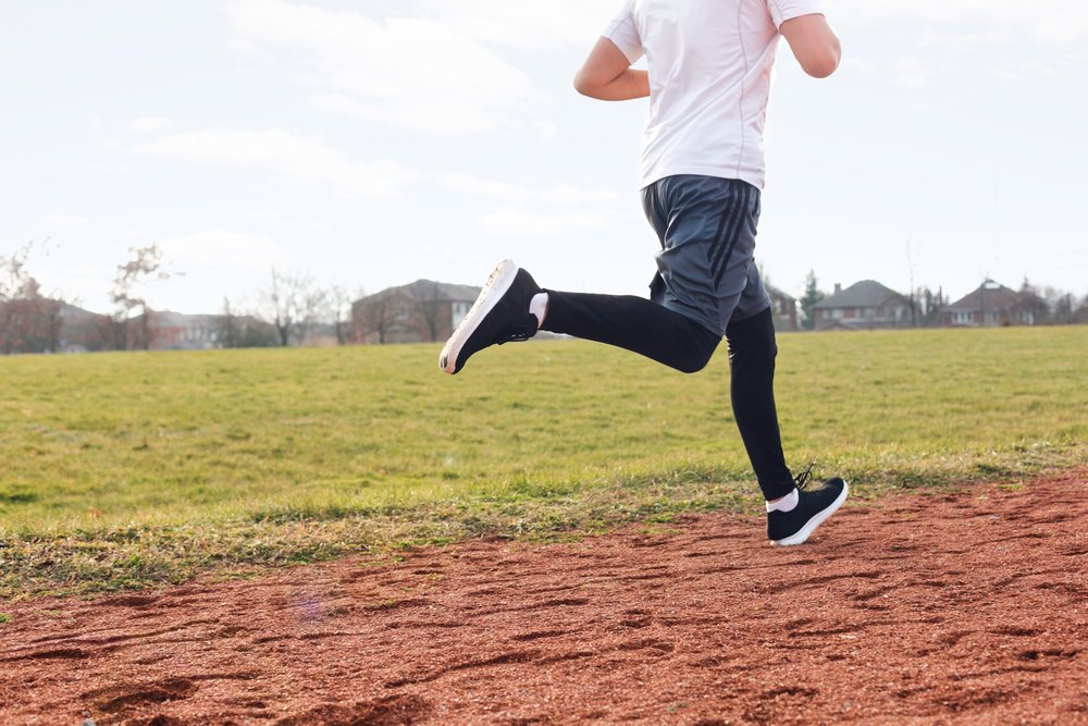 legs-running-on-track_4460x4460.jpg