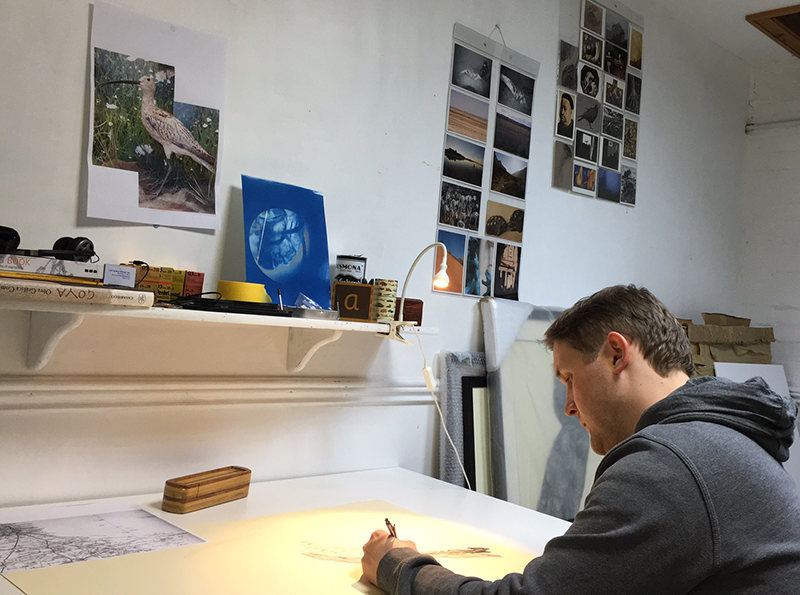 Chris Otley working in his artist studio