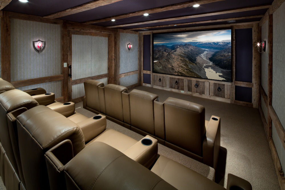 Large home theater with brown leather chairs.