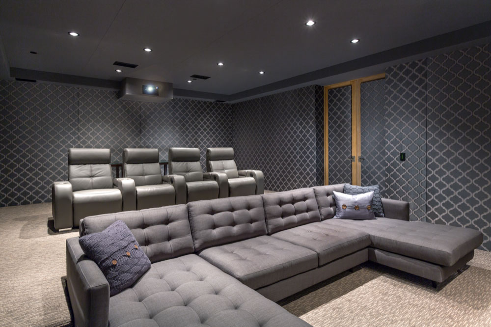 Luxurious grey leather couches and home theater chairs