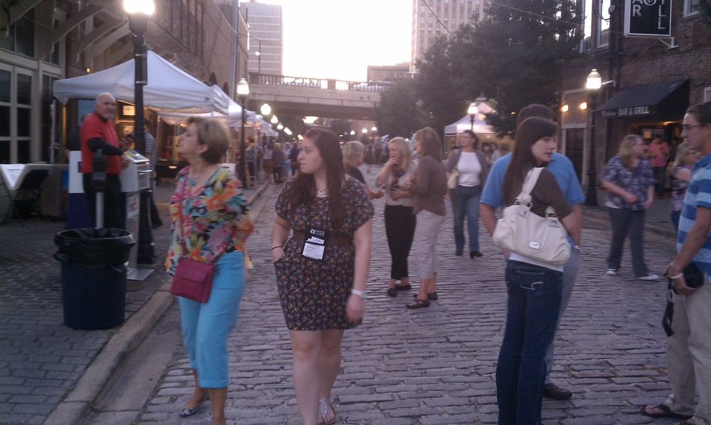 People shopping in the street during Artwalk