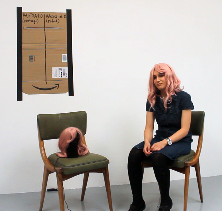 """Alexa vs. Alexa"" (performance at Almanac Projects), 2018  As part of ""Beyond the Standard Model"" at Almanac Projects, I showed ""Alexa vs. Alexa"", a game-show style performance in which audience members asked the Amazon Echo and me the same questions, poking fun at debates around automation.  Link to video documentation:   https://www.youtube.com/watch?v=clYTkTJkrgo"