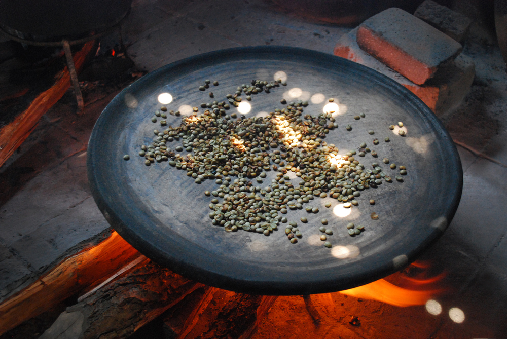 Roasting organic coffee beans over an open fire