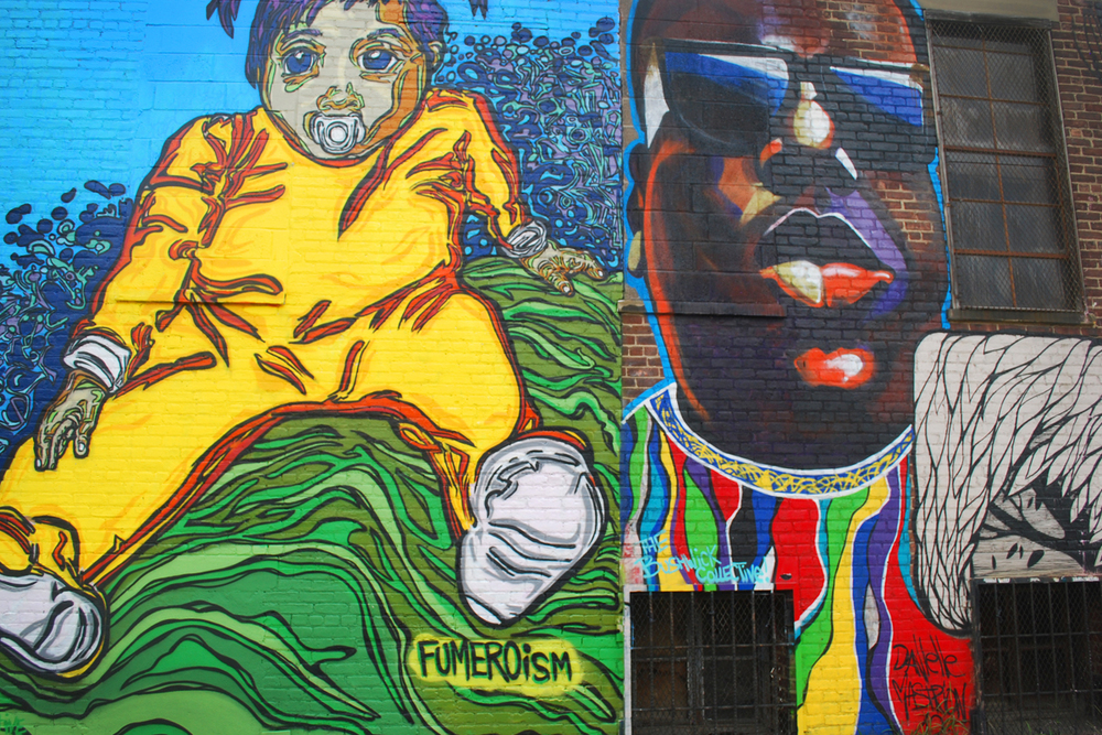 Mural on left by Fumero and mural on the right by Danielle Mastrion.