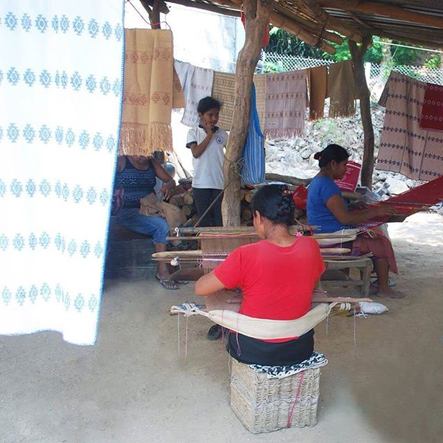 Backstrap weavers on the coast of Oaxaca working together collaboratively on a custom order of cotton huipiles and rebozos. You can see some of their traditional artistry in the foreground and background of the image. #backstrap #weaving #hechoenmexico