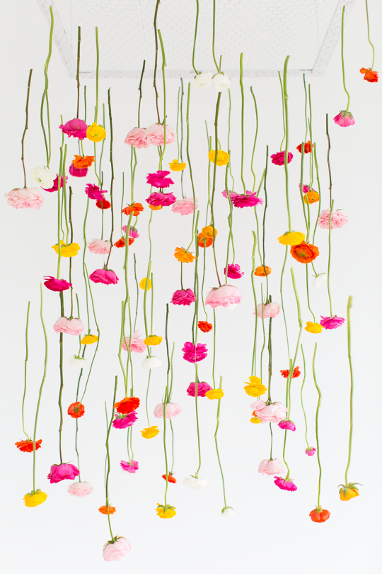 http://sugarandcloth.com/2015/01/diy-hanging-flower-installation/