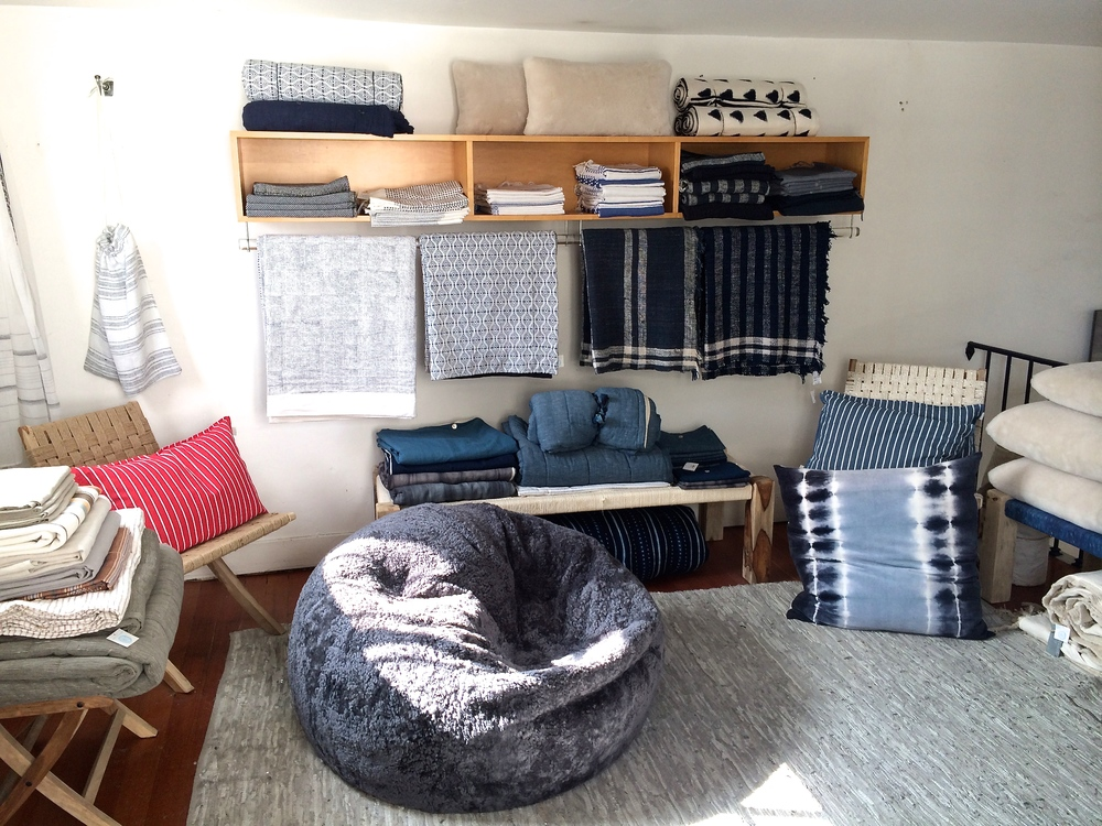 Pillows, blankets and other home fabrics in the upstairs loft.