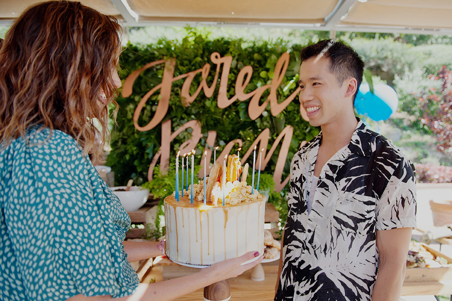 """Actress, Georgie Flores, presents Jared with his birthday cake, as his friends sang """"Happy Birthday."""""""