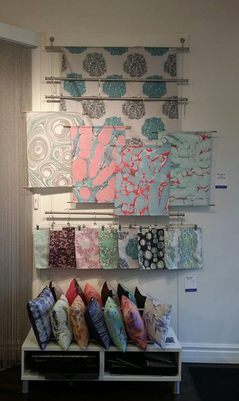 Prillamena's display for the Art Walk. We featured our fabric, pillows, and wallhangings