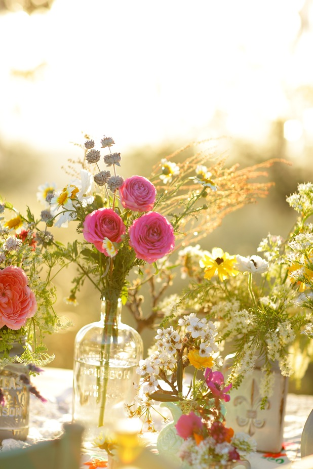 Centerpieces with jars, wildflowers and roses