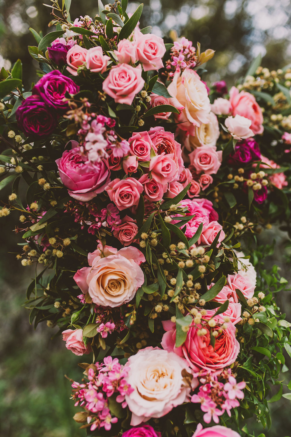 Garden Roses adorned ceremony backdrop