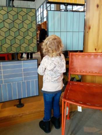 Toddler G getting her first lesson in ceramic tiles at Heath Ceramics