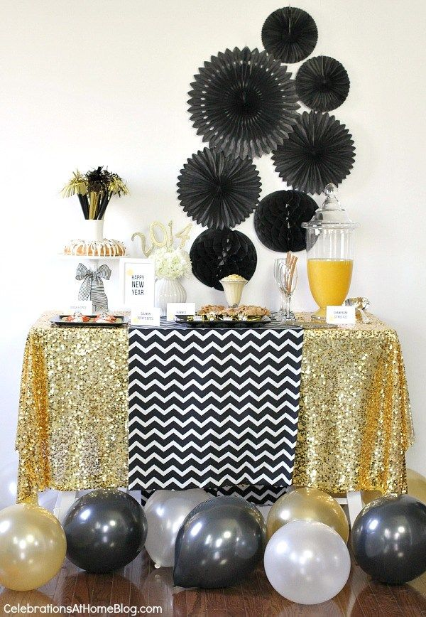 Fun gold tablescape by  Celebrations at Home