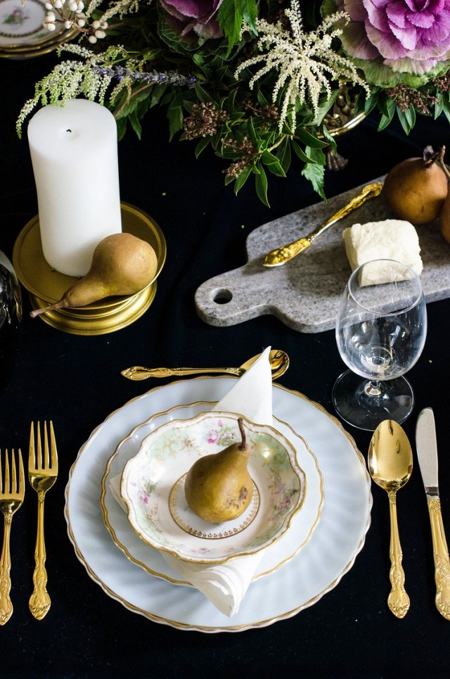 A moody black table setting via  Rose & Ivy