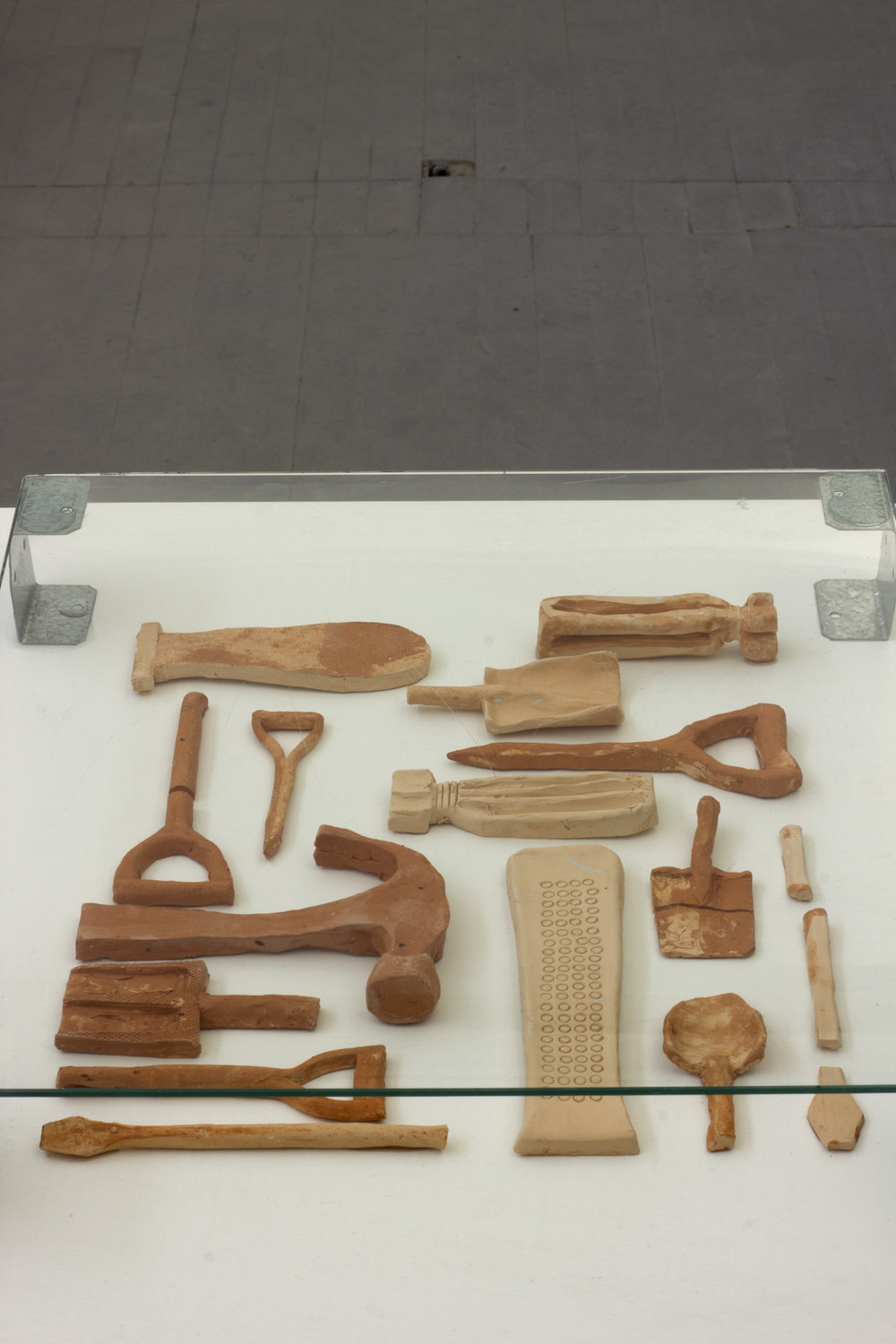 ' A collection of memorised tools' Fired clay under glass 37 x 42 cm.jpg