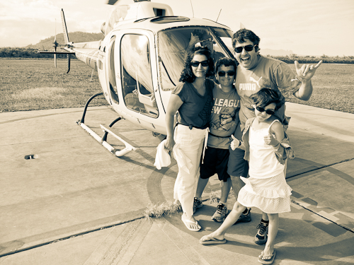 Family outside of helicopter
