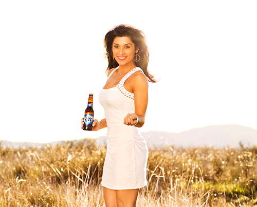 Model posing with beer