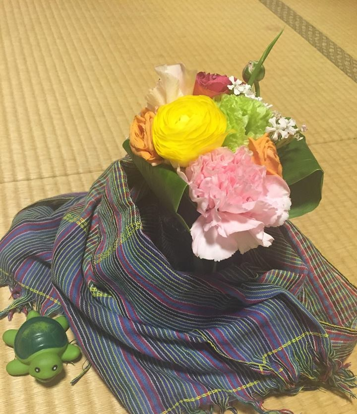 Flowers, cloth and the 'flying turtle' talking object.