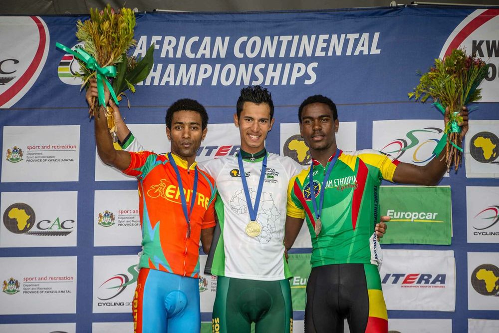South Africa also claimed the gold in the Under 23 Men's Road Race with Jayde Julius (centre) beating Merhawi Kudus of Eritrea (left) and Temesgen Buru of Ethiopia (right) to the top step of the podium on day six of the 2015 Confederation of African Cycling African Road Championships on Saturday © craigdutton.com